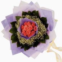 12 adet gül ve elyaflardan   Gölbaşı çiçek kaliteli taze ve ucuz çiçekler