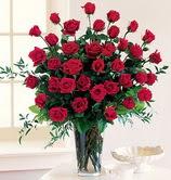 Gölbaşı çiçekçi güvenli kaliteli hızlı çiçek  12 adet essiz kirmizi gül demeti cam yada mika vazoda