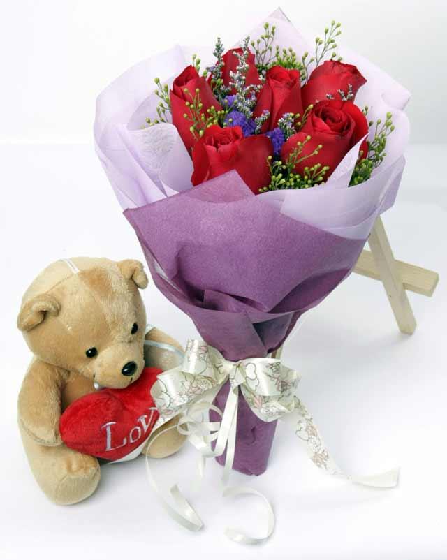 oyuncak ve 7 adet kirmizi gül buketi  Ankara Gölbaşı çiçek siparişi vermek