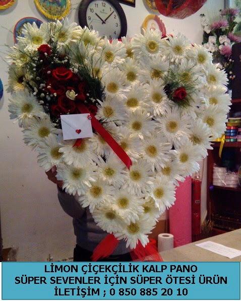 21 adet kırmızı gül süper kalpte ve gerbera çiçeği